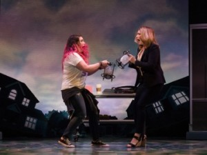 Mother (Heidi Blickenstaff) and daughter (Emma Hunton) fight constantly, as seen here over control of a hourglass.
